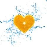 Skiva av den hjärta formade apelsinen Royaltyfri Foto