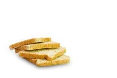 Skiva av ett isolerat bröd för helt vete royaltyfri foto