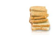 Skiva av ett isolerat bröd för helt vete Arkivfoto