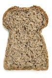 Skiva av kärnat ur bröd som isoleras på vit Royaltyfria Foton