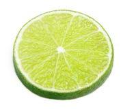 Skiva av limefruktcitrusfrukt som isoleras på vit Royaltyfri Bild