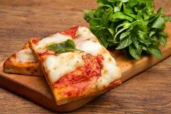 Skiva av pizza royaltyfria bilder