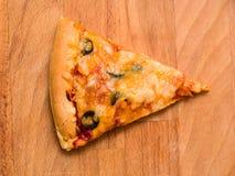 Skiva av pizza Arkivbild