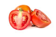 Skiva av tomaten som isoleras på vit bakgrund Royaltyfri Bild