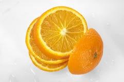 Skivad apelsin Arkivbild