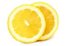 Skivad citron som isoleras p? vit bakgrund royaltyfria foton