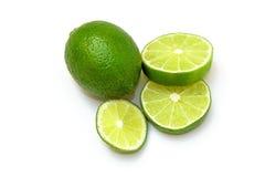 Skivad hel limefrukt för ââand Royaltyfri Foto