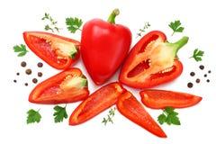 skivad söt spansk peppar, vitlök och persilja som isoleras på vit bakgrund Top beskådar arkivbild