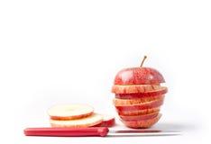 skivad white för äpplebakgrund red Fotografering för Bildbyråer