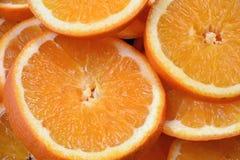 Skivade frukt- bakgrund för den ljusa orange designen från cirklarna orange blad Fotografering för Bildbyråer