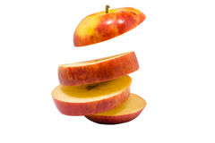 Skivat äpple över vit bakgrund Fotografering för Bildbyråer