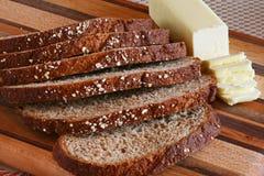 Skivat bröd med smörpinnen Fotografering för Bildbyråer