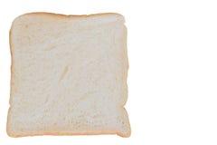 skivat bröd som isoleras Arkivfoto
