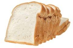 Skivat bröd som isoleras på vit bakgrund Royaltyfri Foto
