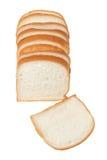 Skivat bröd som isoleras på vit bakgrund Royaltyfria Bilder