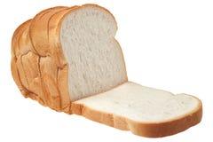 Skivat bröd som isoleras på vit bakgrund Royaltyfri Fotografi