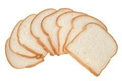 Skivat bröd som isoleras på vit bakgrund Arkivfoton
