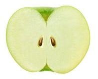 Skivat i halvagräsplanäpplet som isoleras på vit med den snabba banan Arkivbild