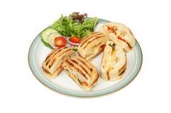 Skivor av en panini med sallader royaltyfri foto