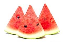 Skivor av vattenmelon som isoleras på vit Arkivbild