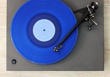 Skivtallrik som spelar rekordet arkivfoto