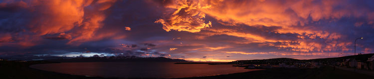 Sunset, Iceland. Skjalfandi Bay sunset viewed from Husavik, Iceland, the whalewatching capital of Europe. Fiery sky with the colours purple and red and pink and royalty free stock photography