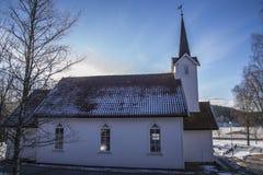Skjeberg-dal kyrka (norden) Arkivfoto