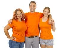 Skjortor för apelsin för folk bärande tomma royaltyfri fotografi