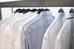 Skjortor för man` s på hängare 3 royaltyfria foton
