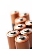 Skjuten makro för AA-batteriöverkanter Arkivbilder