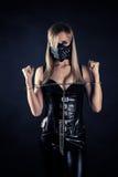 Sklave in einer Maske mit Spitzen Stockbild