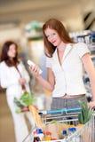 sklepu spożywczy zakupy sklepu włosiana czerwona kobieta Obrazy Royalty Free