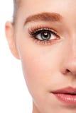 Skönhetöga och halv framsida Fotografering för Bildbyråer