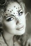 Skönhetkvinna med makeup i stil för snöleopard Modemakeup M Royaltyfri Fotografi
