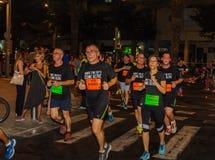 Skołowanie biegacze jest oczywisty po 8 kilometrów Obrazy Stock