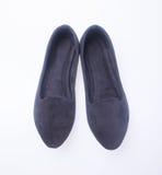 sko svarta skor för färgmodekvinna på en bakgrund Royaltyfri Bild