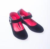 sko svarta skor för färgmodekvinna på en bakgrund Royaltyfria Foton