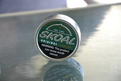 SKOAL ORIGINAL. LEWISTON/IDAHO /USA- Skoal original hand slected 100% american grown  tobacco warning this productcan cause mouth cancer         31 May 2014  ( Royalty Free Stock Photo