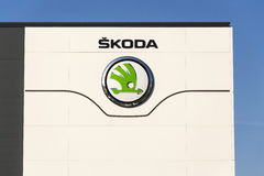 Skoda Auto automobile manufacturer from Volkswagen Group company logo in front of dealership building Stock Images