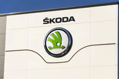 Skoda Auto automobile manufacturer from Volkswagen Group company logo in front of dealership building Royalty Free Stock Image