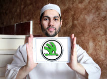 Skoda car logo. Logo of Skoda car brand on samsung tablet holded by arab muslim man Royalty Free Stock Photo