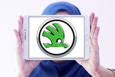 Skoda car logo. Logo of Skoda car brand on samsung tablet holded by arab muslim woman royalty free stock images