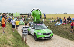 Skoda Caravan on a Cobblestone Road- Tour de France 2015 Royalty Free Stock Photo