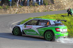 Skoda Fabia competitive engaged during the 64th rally of Sanremo. Peugeot 208 Competitive engaged during the 64th rally of Sanremo conducted in the race crew Royalty Free Stock Image