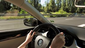 Skoda New car woman driving POV. Alsace, France - circa 2018: Point of view woman driving electric Skoda car - view car interior to the road with Apple Car Play stock footage