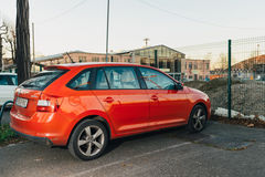 Skoda Rapid - red car parked in city Stock Photos