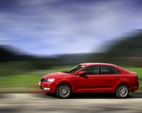 Skoda red car. Skoda red car on blurred in motion background stock image