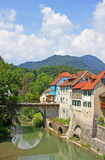 Skofja Loka old houses by river Stock Photos