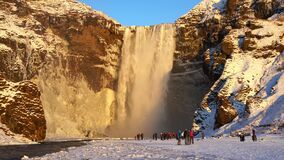 Skogafoss, Iceland 11. December 2019. Skogafoss waterfall is one of the most famous waterfalls in Iceland. Massive and powerful st