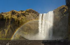 Skogafoss iceland waterfall with a rainbow and a beautiful sky in southern iceland stock image